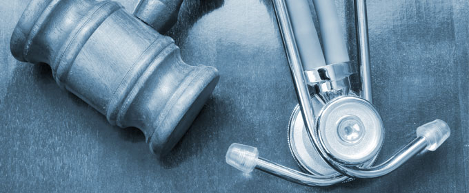 Gavel and stethoscope with blue tint