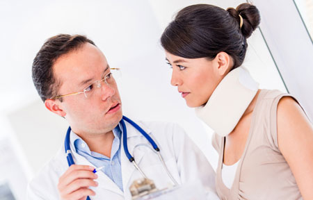 Doctor speaks with female patient in neck brace